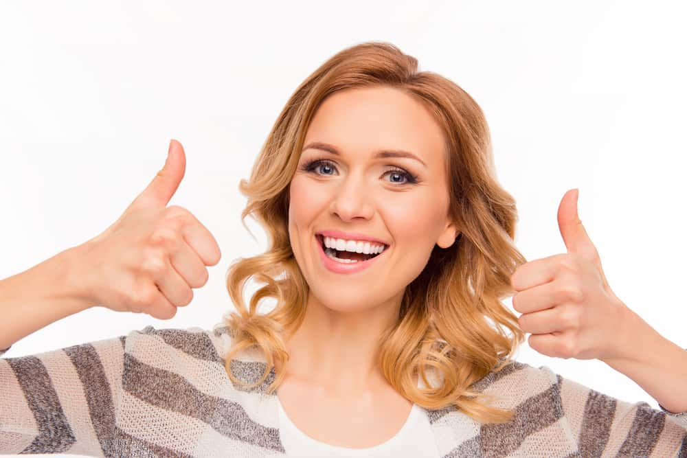 happy smiling woman showing fists and gesturing