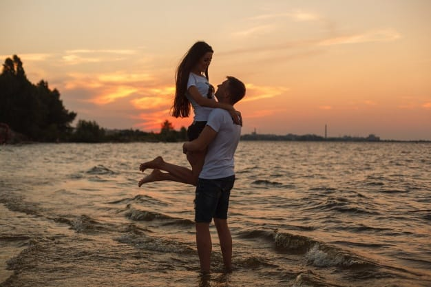 love story couple hugging beach sunset healthy happy